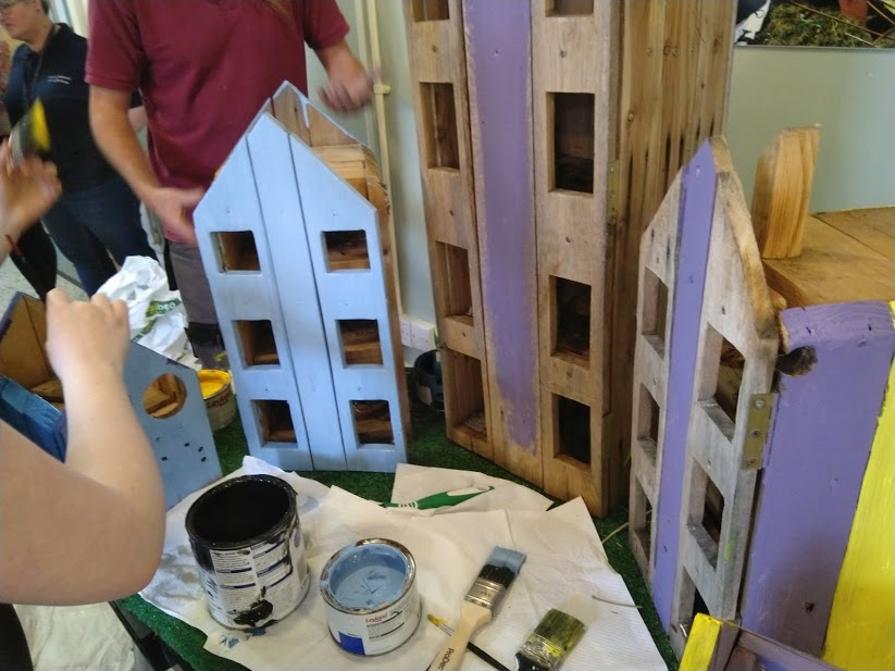 bug houses being painted