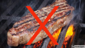 Steak with red cross over it for cutting carbon article