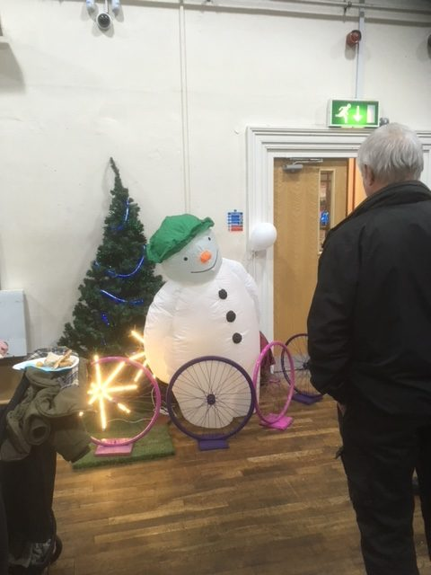 Pedal powered snowman at Landfill Christmas celebration event