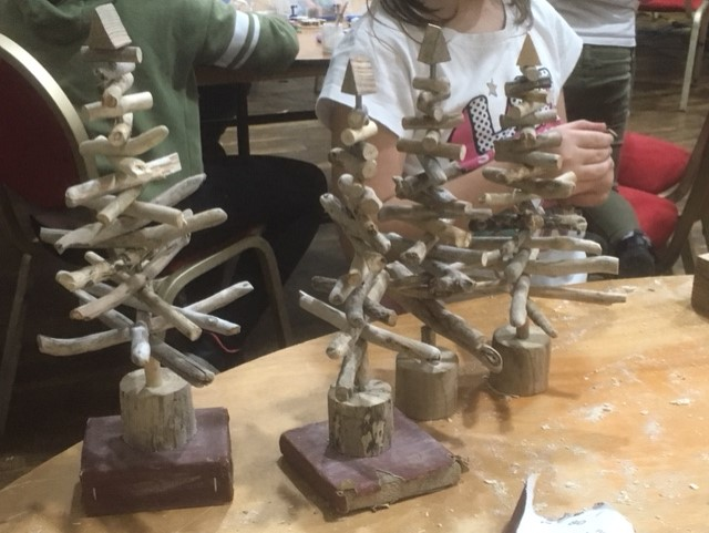 Driftwood christmas trees at Landfill Christmas celebration event